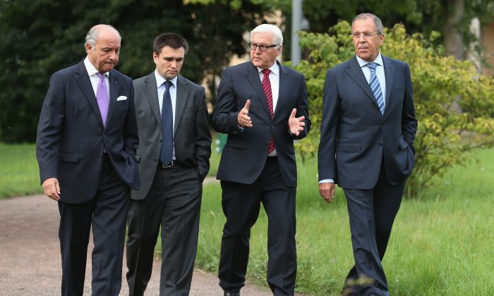 (L-R) French Foreign Minister Laurent Fabius, Ukrainian Foreign Minister Pavlo Klimkin, German Foreign Minister Frank-Walter Steinmeier and Russian Foreign Minister Sergey Lavrov walk in the villa garden while meeting to discuss the ongoing conflict in eastern Ukraine at Villa Borsig on August 17, 2014, in Berlin, Germany. There has been at least one confirmed incursion by military vehicles from Russian soil into Ukraine. (Sean Gallup/Getty Images)