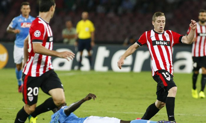 Bilbao's Spanish forward Iker Muniain (R) fights for the ball with Napoli's French defender Kalidou Koulibaly during the first leg of the UEFA Champions League play off football match between SSC Napoli and Bilbao Athletic Club in San Paolo Stadium on August 19, 2014. (CARLO HERMANN/AFP/Getty Images)