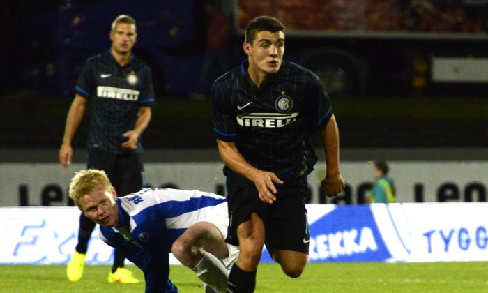 nter Milan's Croatian midfielder Mateo Kovacic (R) breaks a tackle from Stjarnan's Thorri Geir Runarsson (L) during the UEFA Europa League play off match between Stjarnan and Inter Milan at the Laugardalsvollur stadium in Reykjavik on August 20, 2014. Inter Milan defeated Stjarnan 3-0. (HALLDOR KOLBEINS/AFP/Getty Images)