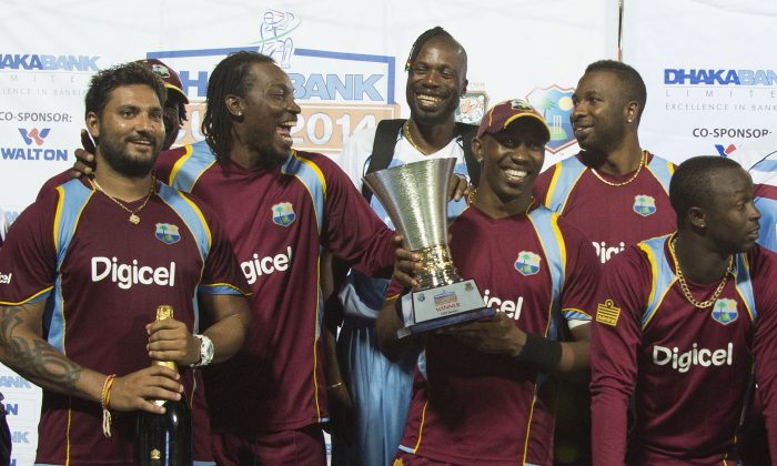 The West Indies team poses with the Dhaka Bank Cup after winning the One Day International series between the West Indies and Bangladesh 3 to nil at the Warner Park cricket ground in Basseterre, Saint Kitts and Nevis, August 25, 2014. (Jim Watson/AFP/Getty Images)