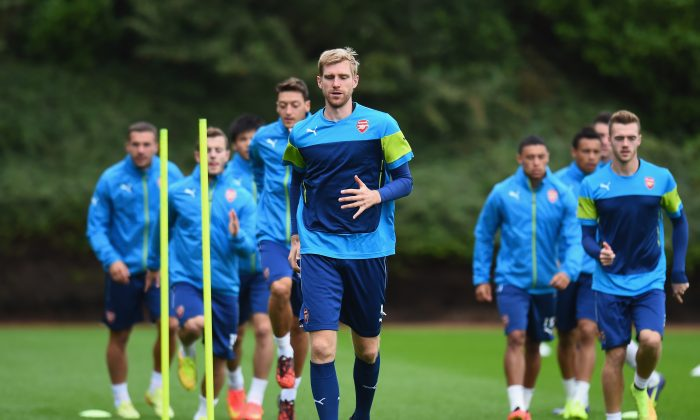 Per Mertesacker of Arsenal warms-up during a training session at London Colney on August 26, 2014 in St Albans, England. (Photo by Shaun Botterill/Getty Images)