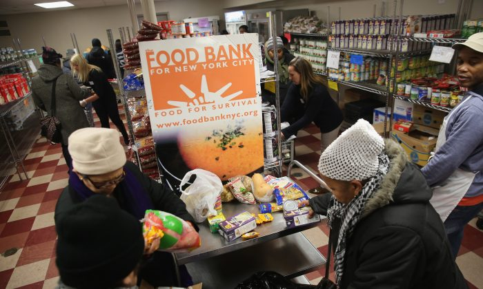 Harlem residents choose free groceries at the Food Bank For New York City on Dec. 11, 2013. (John Moore/Getty Images)