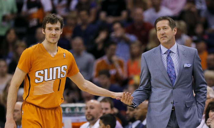 Phoenix Suns' Goran Dragic (1), of Slovenia, gives five to coach Jeff Hornacek in this file photo. Goran and his brother Zoran are leading the Slovenian national team in the World Cup. (AP Photo/Matt York)