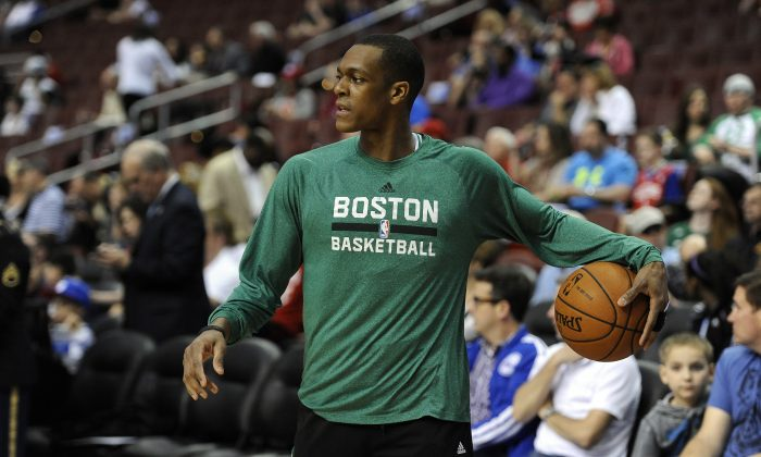 Boston Celtics' Rajon Rondo is seen before an NBA basketball game against the Philadelphia 76ers on Monday, April 14, 2014, in Philadelphia. (AP Photo/Michael Perez)