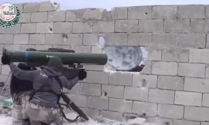 A screenshot from a YouTube video shows rebels firing Chinese HJ-8 anti-tank missiles allegedly into a Syrian army artillery base. China will soon release a new anti-tank weapon able to destroy current-generation tanks, which it plans to sell. (Epoch Times)