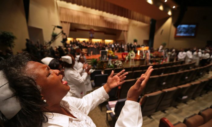 A woman sings during the funeral for 18-year-old Michael Brown at Friendly Temple Missionary Baptist Church in St. Louis on Monday. (St. Louis Post Dispatch, Robert Cohen/AP)
