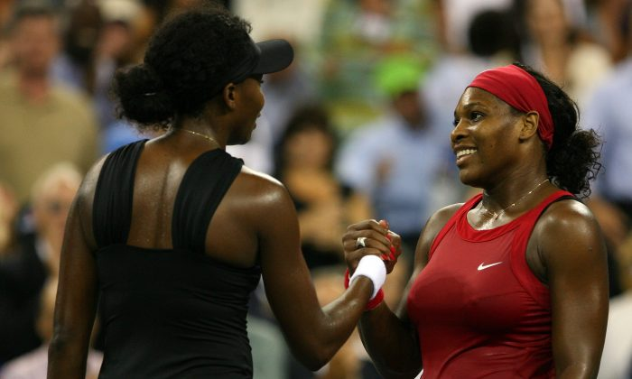 Serena Williams (R) shakes hands with Venus Williams after Serena defeated Venus during Day 10 of the 2008 U.S. Open at the USTA Billie Jean King National Tennis Center on September 3, 2008 in the Flushing neighborhood of the Queens borough of New York City. (Matthew Stockman/Getty Images)