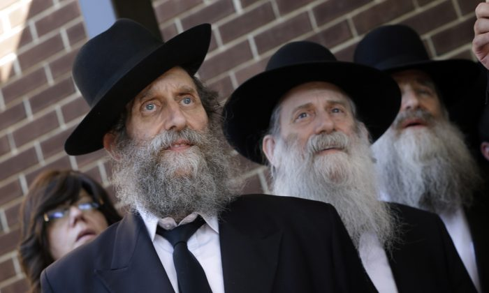 People listen during a news conference about the disappearance, in Israeli, of Aaron Sofer, 23, Tuesday, Aug. 26, 2014, in Lakewood, N.J. (AP Photo/Mel Evans)