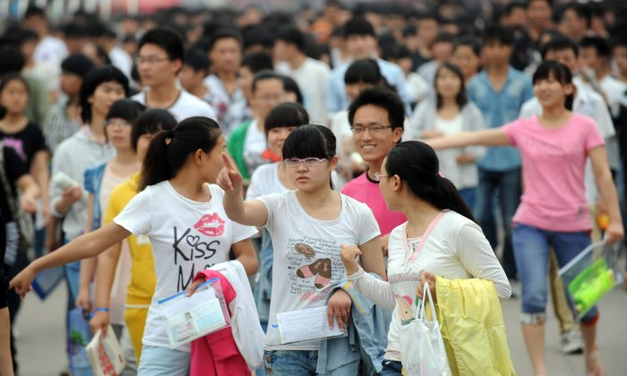 Students walk at a schoolyard before sitting the 2013 university entrance exam in Bozhou, north China's Anhui province on June 7, 2013. (AFP/Getty Images)