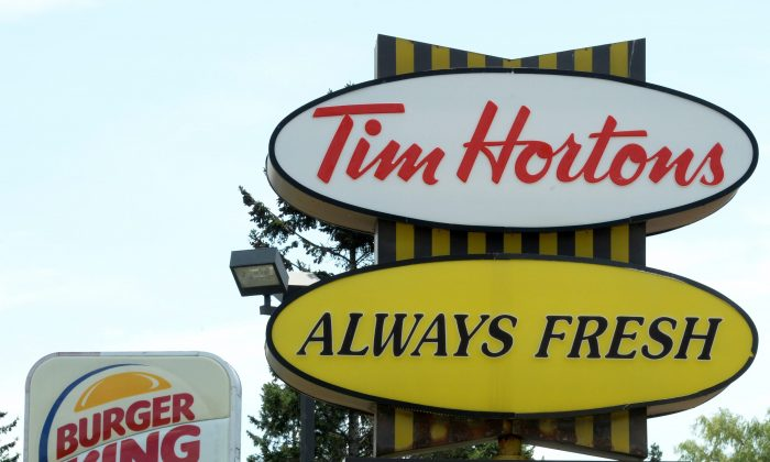Burger King and Tim Hortons locations in close proximity in Ottawa, Canada. (AP Photo/The Canadian Press, Sean Kilpatrick)