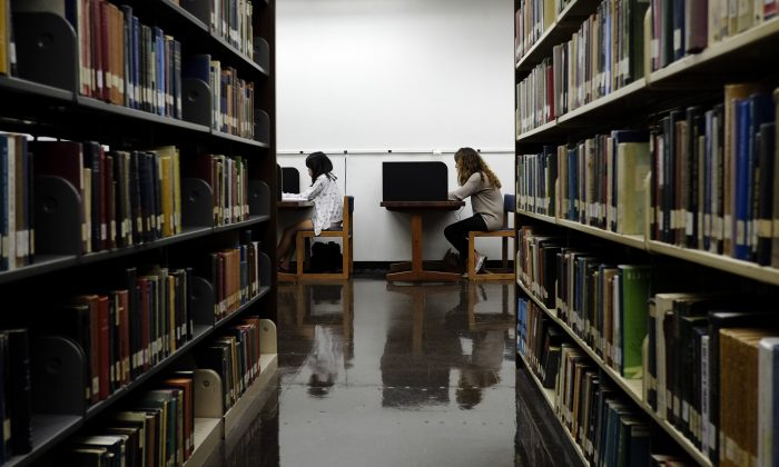 Students study in a library on the campus of California State University, Long Beach, in Long Beach, Calif., on Oct. 19, 2012. (Jae C. Hong/AP Photo)