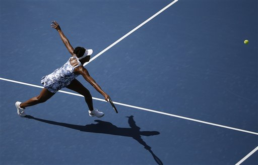 Venus Williams, of the United States, lunges for a shot against Kimiko Date-Krumm, of Japan, during the opening round of the 2014 U.S. Open tennis tournament, Monday, Aug. 25, 2014, in New York. (AP Photo/Elise Amendola)