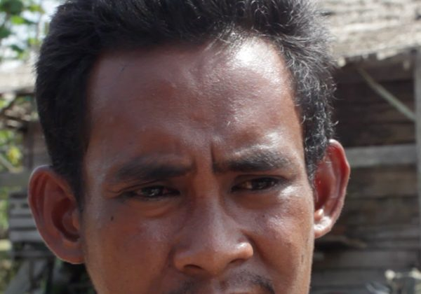 """""""I make six times the amount of money logging as I would working my small plot of land or even working legally in a pulp and paper or palm oil plantation."""" An illegal logger explains the economic conditions in South Sumatra. Photo by Robert S. Eshelman."""