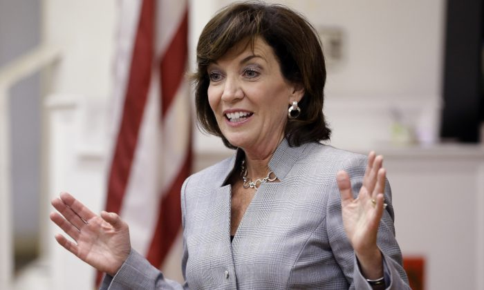In this Aug. 6, 2014 file photo, New York state Lt. Gov. candidate Kathy Hochul speaks to an audience while attending the New Kings Democrats Meeting in the Brooklyn borough of New York. Hochul is facing a primary challenge from Columbia University law professor Tim Wu. (AP Photo/Frank Franklin II, File)