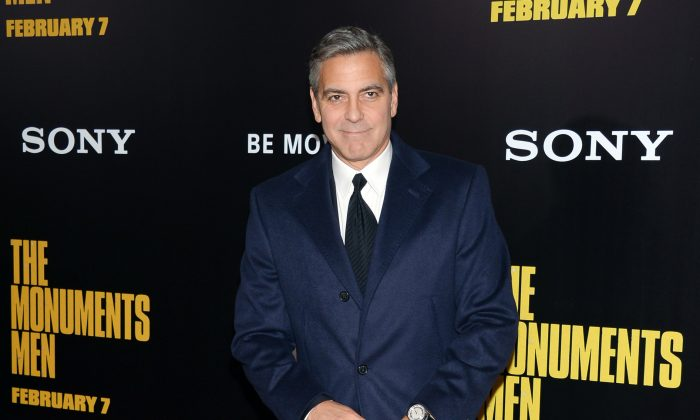 """In this Feb. 4, 2014 file, director and actor George Clooney attends the premiere of """"The Monuments Men"""" at the Ziegfeld Theatre in New York. Clooney, 52, Hollywood's most determined bachelor famous for a litany of fleeting loves, has taken himself off the romantic market and proposed to 36-year-old attorney, Amal Alamuddin. (Evan Agostini/Invision/AP, file)"""