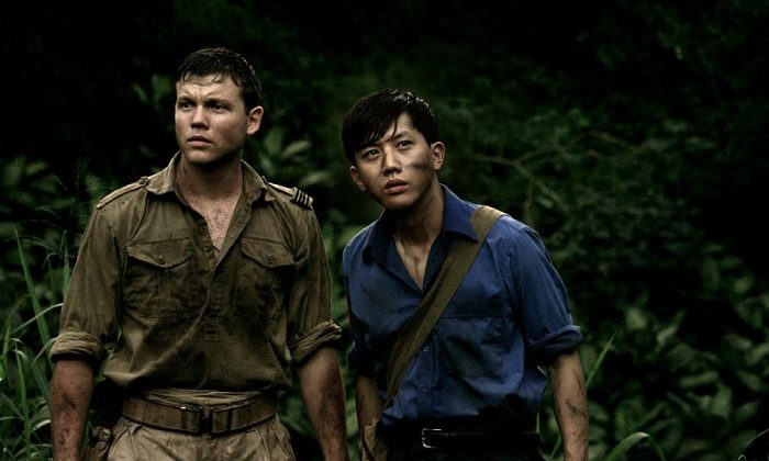 """Khan Chittenden and Mo Tzu-yi as World War II soldiers lost in the jungle in """"Canopy."""" (Monterey Media)"""
