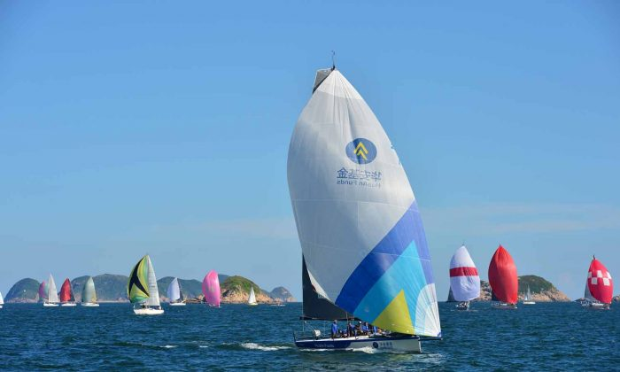 Boats sailing downwind during Race-9 of the Quest Yachting Typhoon Series on Saturday Aug 23, 2014. (Bill Cox/Epoch Times)