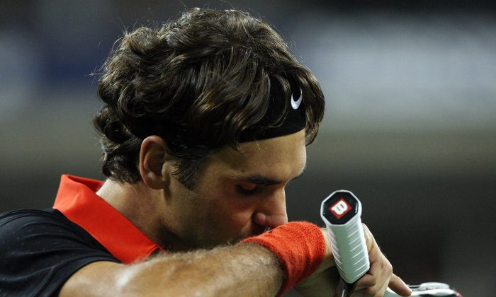 Roger Federer reacts during his five-set loss to Juan Martin Del Potro in the 2009 U.S. Open finals. (Jim McIsaac/Getty Images)