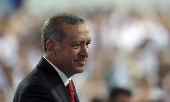 President-elect Recep Tayyip Erdogan addresses his supporters in Ankara, Turkey, Wednesday, Aug. 27, 2014. (AP Photo/Burhan Ozbilici)