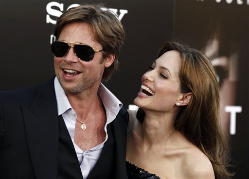 """In this Monday, July 19, 2010, file photo, cast member Angelina Jolie, right and Brad Pitt arrive at the premiere of """"Salt"""" in Los Angeles. Jolie and Pitt were married Saturday, Aug. 23, 2014, in France, according to a spokesman for the couple. (AP Photo/Matt Sayles, File)"""