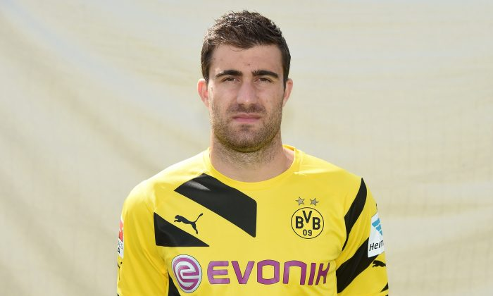Dortmund's Greek defender Sokratis poses for a photograph during the team presentation of German first division Bundesliga football club Borussia Dortmund at the training ground in Brackel, western Germany, on August 11, 2014. (PATRIK STOLLARZ/AFP/Getty Images)