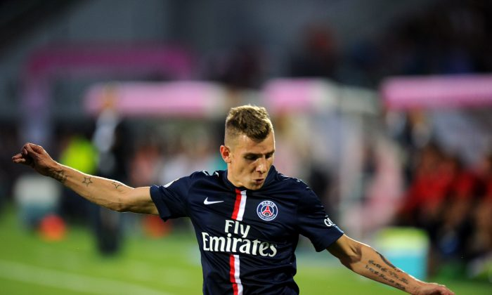 Paris Saint-Germain's French defender Lucas Digne vies for the ball during the French L1 football match between Evian Thonon Gaillard (ETGFC) and Paris Saint-Germain (PSG) on August 22, 2014 at the Parc des Sport in Annecy, southeastern France. (JEAN-PIERRE CLATOT/AFP/Getty Images)