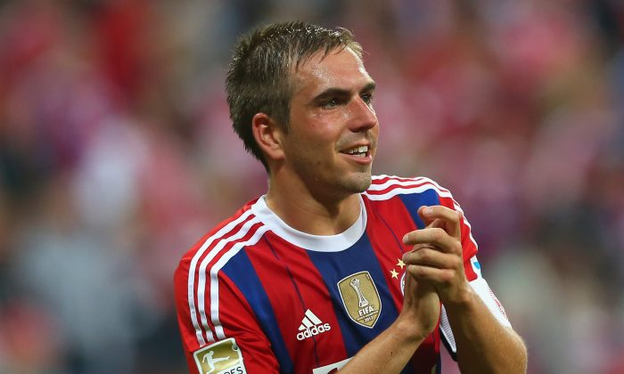 Philipp Lahm of Muenchen looks on during the Bundesliga match between FC Bayern Muenchen and VfL Wolfsburg at Allianz Arena on August 22, 2014 in Munich, Germany. (Photo by Alexander Hassenstein/Bongarts/Getty Images)
