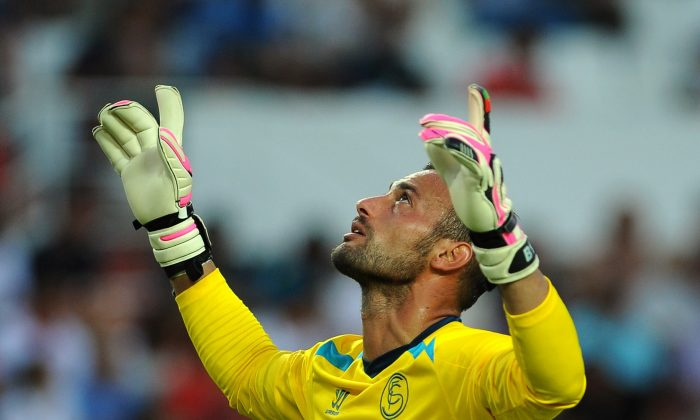 Sevilla's Portuguese goalkeeper Beto gestures during the Spanish league football match Sevilla FC vs Valencia CF at the Ramon Sanchez Pizjuan stadium in Sevilla on August 23, 2014. (CRISTINA QUICLER/AFP/Getty Images)
