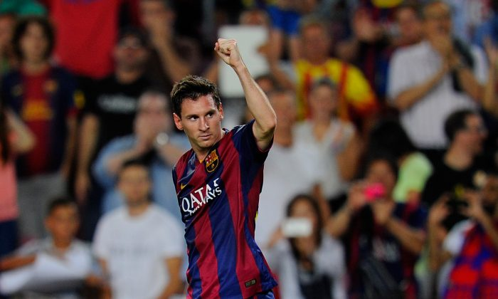 Lionel Messi of FC Barcelona celebrates scoring his team's opening goal during the La Liga match between FC Barcelona and Elche FC at Camp Nou stadium on August 24, 2014 in Barcelona, Spain. (Photo by Denis Doyle/Getty Images)