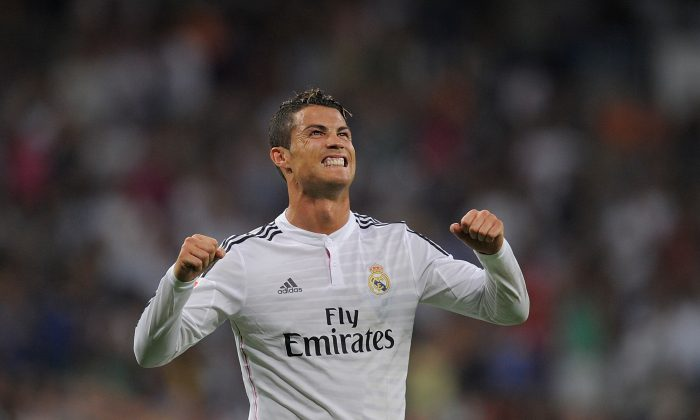 Cristiano Ronaldo of Real Madrid celebrates after scoring Real's 2nd goal during the La liga match between Real Madrid CF and Cordoba CF at Estadio Santiago Bernabeu on August 25, 2014 in Madrid, Spain. (Photo by Denis Doyle/Getty Images)