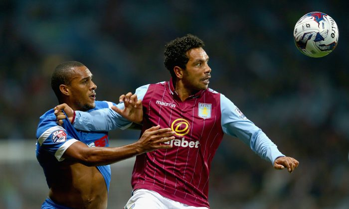 Kieran Richardson of Aston Villa holds off a challenge from Marvin Bartley of Leyton Orient during the Capital One Cup second round match between Aston Villa and Leyton Orient at Villa Park on August 27, 2014 in Birmingham, England. (Photo by Clive Mason/Getty Images)
