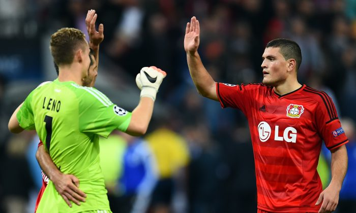 Kyriakos Papadopoulos of Leverkusen celebrates with goalkeeper Bernd Leno after winning the UEFA Champions League Qualifying Play-Offs Round second leg match between Bayer Leverkusen and FC Copenhagen on August 27, 2014 in Leverkusen, Germany. (Photo by Lars Baron/Bongarts/Getty Images)