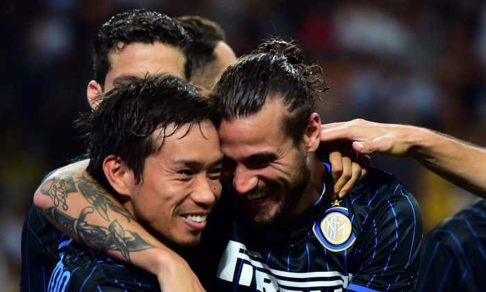 Inter Milan's forward Pablo Osvaldo (R) celebrates with Inter Milan's japanese midfielder Yuto Nagatomo (L) after scoring a goal during the UEFA Europa League play-off football match between Inter Milan vs Stjarnan at San Siro Stadium in Milan on August 28, 2014. (GIUSEPPE CACACE/AFP/Getty Images)