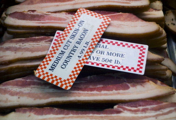 International Bacon Day is Saturday. Skin on Bacon is seen for sale at the Eastern Market February 25, 2014, in Washington, DC. AFP PHOTO/Paul J. Richards (Photo credit should read PAUL J. RICHARDS/AFP/Getty Images)