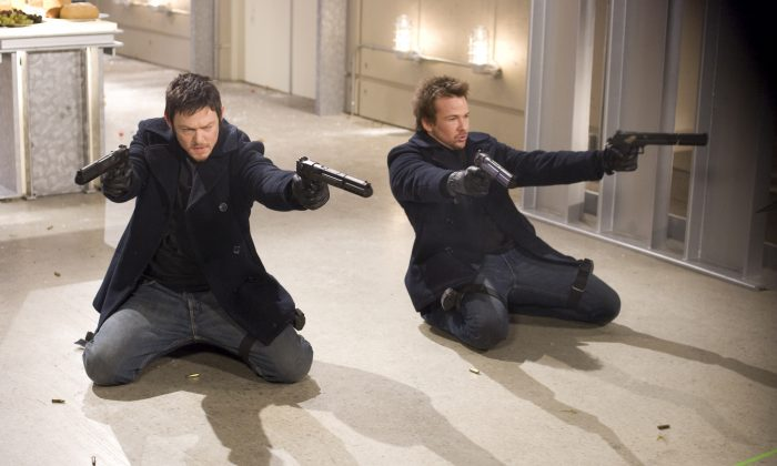 "In this film publicity image released by Apparition Films, Norman Reedus, left, and Sean Patrick Flanery are shown in a scene from ""The Boondock Saints II: All Saints Day."" (AP Photo/Apparition Films)"