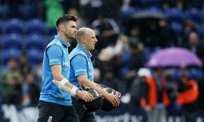 England's James Anderson, left, and teammate James Tredwell walks off the pitch after India defeated England during their One Day International cricket match at the SWALEC cricket ground in Cardiff, Wales, Wednesday, Aug. 27, 2014. (AP Photo/Alastair Grant)