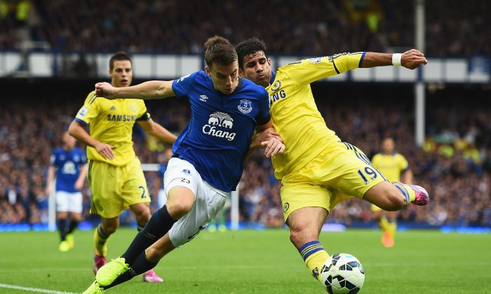 Diego Costa of Chelsea tackles Seamus Coleman of Everton during the Barclays Premier League match between Everton and Chelsea at Goodison Park on August 30, 2014 in Liverpool, England. (Photo by Laurence Griffiths/Getty Images)