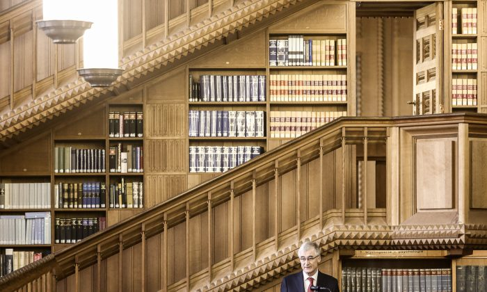 Flemish Minister of Domestic Policy, Integration and Tourism Geert Bourgeois delivers a speech during the opening of the renovated tower of the Louvain university library, on January 6, 2014, in Louvain. (Siska Gremmelprez/AFP/Getty Images)