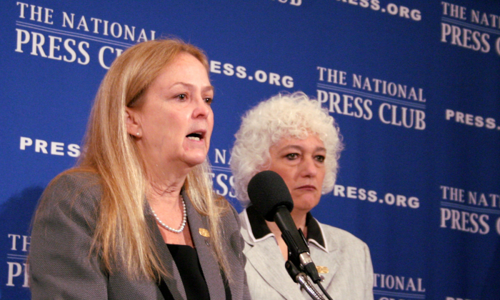 Denise Noonan Slavin (L), a Miami-based immigration judge, and Dana Leigh Marks, a federal administrative judge in San Francisco, speak on the urgent need to remove the immigration court system from the Department of Justice control. They spoke at a news conference at the National Press Club, Aug. 27. (Gary Feuerberg/Epoch Times)
