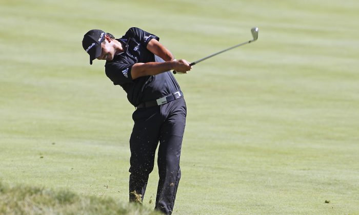 Jason Day hits his second shot on the 14th hole during the first round of the Deutsche Bank Championship golf tournament in Norton, Mass., Friday, Aug. 29, 2014. (AP Photo/Stew Milne)