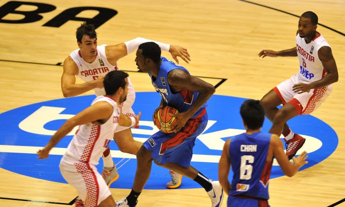 Philippines' centre Andray Blatche holds the ball during the 2014 FIBA World basketball championships group B match Croatia vs Philippines at the Palacio Municipal de Deportes in Sevilla on August 30, 2014. Croatia won the match 81-78. (AFP/Getty Images)
