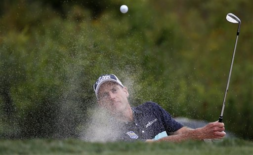 Jim Furyk hits out of a sand trap on the third green during the third round of the Deutsche Bank Championship golf tournament in Norton, Mass., Sunday, Aug. 31, 2014. (AP Photo/Michael Dwyer)
