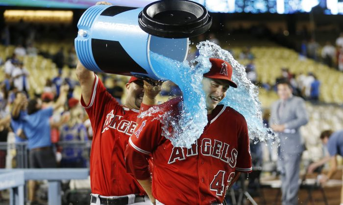 Los Angeles Angels' Albert Pujols, left, pours liquid over starting pitcher Garrett Richards in celebration after Richards pitched a complete game shutout win in a baseball game against the Los Angeles Dodgers, Monday, Aug. 4, 2014, in Los Angeles. The Angels won 5-0. (AP Photo/Danny Moloshok)