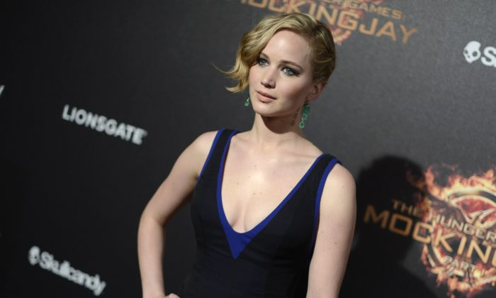 Jennifer Lawrence seen at the Hunger Games: Mockingjay - Part 1 party at the 67th international film festival, Cannes, southern France, Saturday, May 17, 2014. (Arthur Mola/Invision/AP)