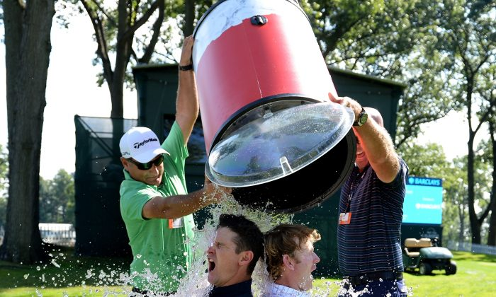 Justin Rose of England and Brandt Snedeker of the USA take the Ice Bucket Challenge prior to The Barclays in Paramus, N.J., on Aug. 19, 2014. (Ross Kinnaird/Getty Images)