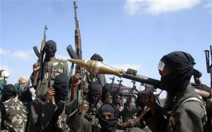 Armed al-shabab fighters on pickup trucks prepare to travel into the city, just outside Mogadishu, in Somalia, in this file photo. The terror group is increasingly crossing into Kenya. (AP Photo/Farah Abdi Warsameh, File)