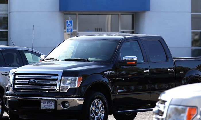 A 2014 Ford F-150 pickup truck is displayed on the sales lot. (Justin Sullivan/Getty Images)