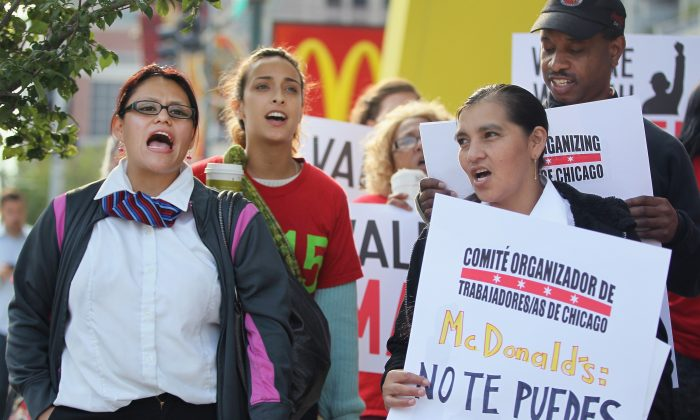Fast food workers and activists demonstrate outside McDonald's downtown flagship restaurant in Chicago on July 31. (Scott Olson/Getty Images)