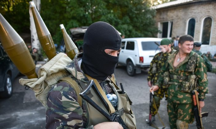 Pro-Russia rebels prepare arms for the the assault on the positions of Ukrainian army in Donetsk airport, eastern Ukraine, on Aug. 31, 2014. (AP Photo/Mstislav Chernov)