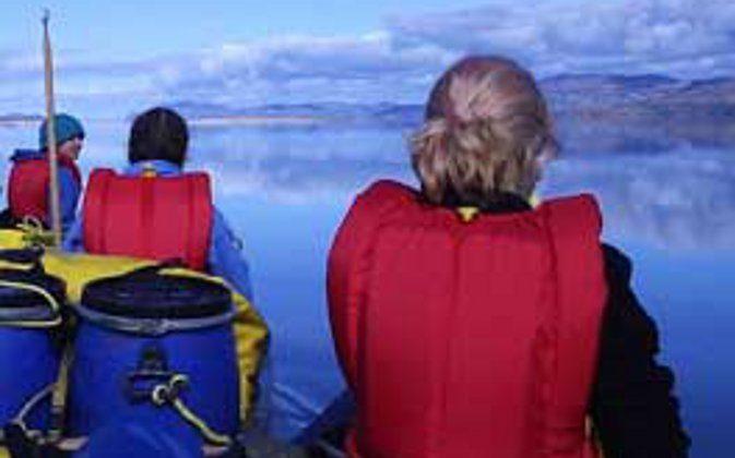 Canoeing under blue skies in the Yukon. (Go Nomad)